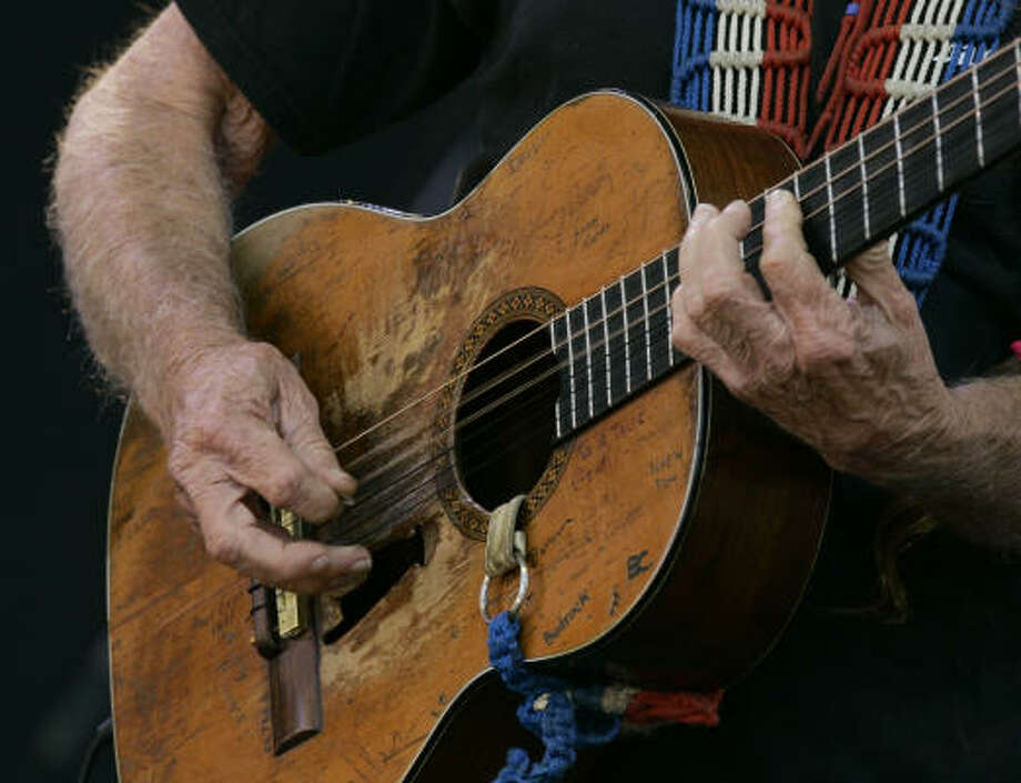 "1969:""Trigger,"" Nelson's trusty and battered Martin N-20 guitar 