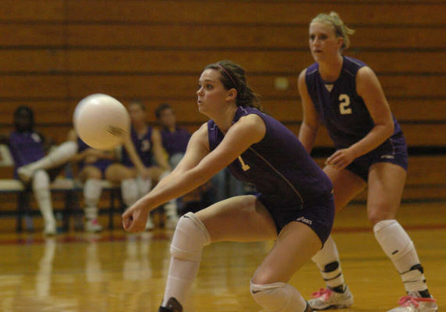 Montgomery volleyball player Mallory Lennon, left, bumps while teammate Amanda Allen, No. 2, looks on. Photo: David Hopper, For The Chronicle