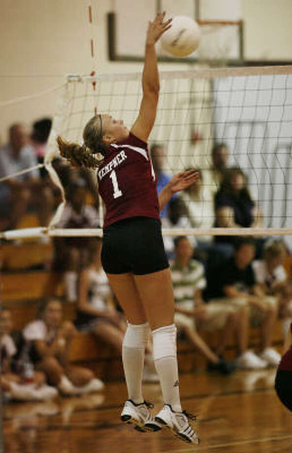 Kempner 's Paige Lavoie connects on a spike in action against Dulles Sept. 8. Photo: Bob Levey, For The Chronicle
