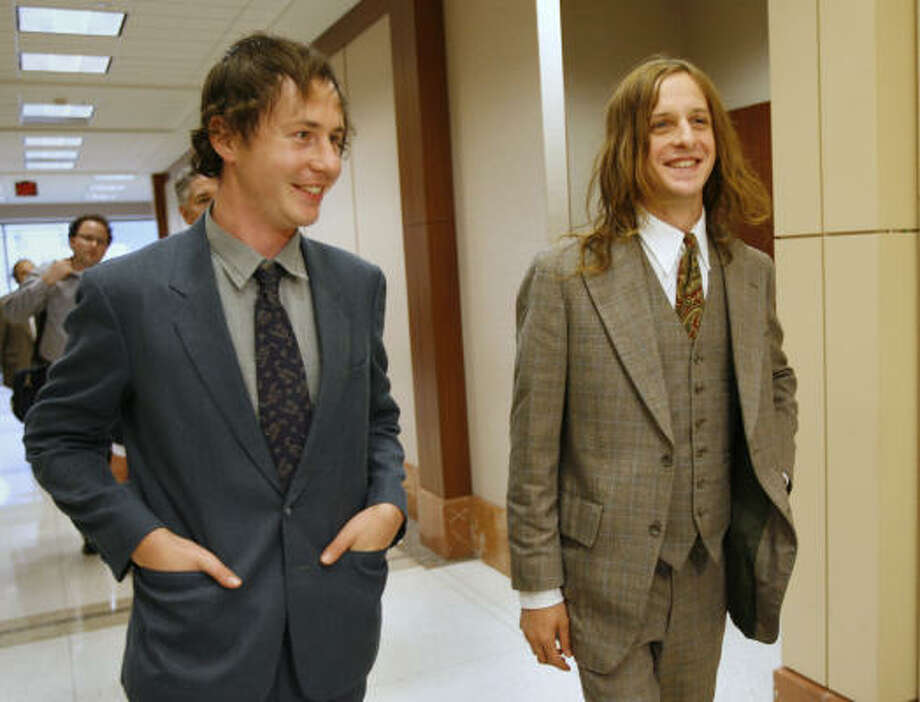 Trainwreck Riders guitarist Andrew James Kerwin, left, and Two Gallants drummer Tyson Vogel leave a courtroom in the Harris County Courthouse Thursday. They joked that they should play a reunion here. Photo: Kevin Fujii, Chronicle
