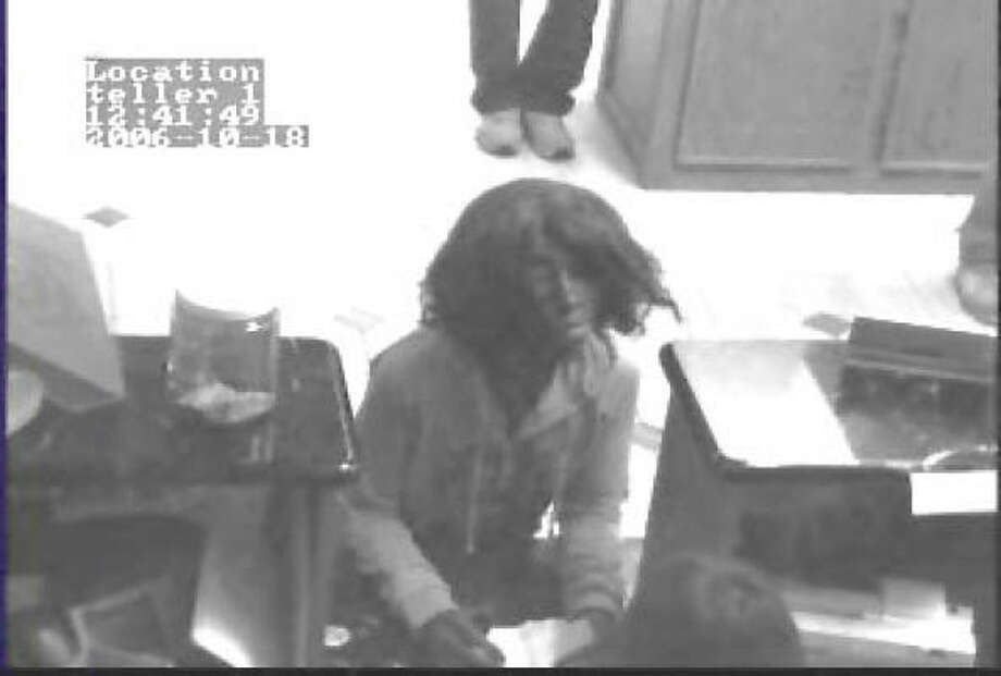 Suspect in bank robberies in surveillance photo. Photo: Montgomery County Sheriff's Office