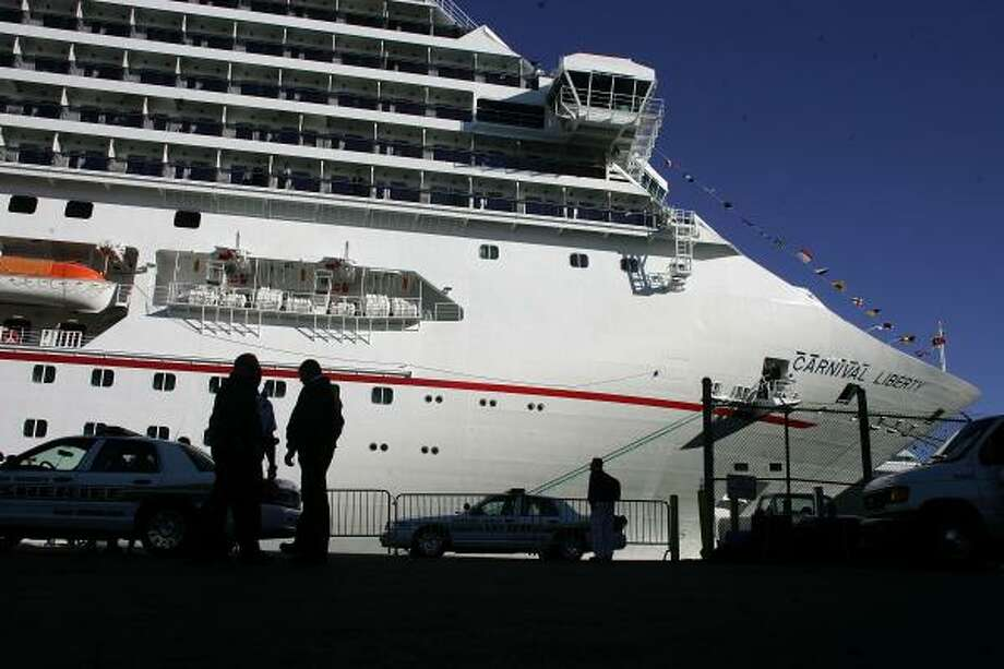 The Carnival Liberty cruise ship docks Sunday at Port Everglades in Fort Lauderdale, Fla., with more than 700 passengers and crew members stricken with stomach virus symptoms that match norovirus. Photo: Joe Raedle, Getty Images