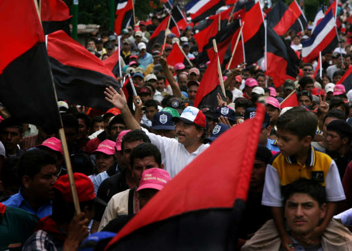 Daniel Ortega, center, presidential candidate of the Frente Sandinista, waves to supporters at a rally campaign in Matagalpa, Nicaragua.