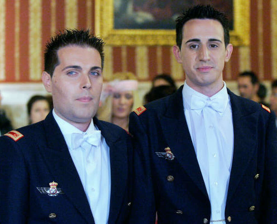 Air force privates Alberto Linero, left, and Alberto Sanchez wore military gala uniforms for their wedding. Photo: JAVIER BARBANCHO, AP