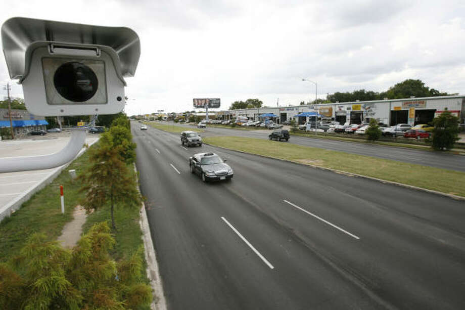 The red-light camera system that has been helping police nab violators is being installed at 10 additional locations in Houston and several state-owned roads. Photo: Chronicle File