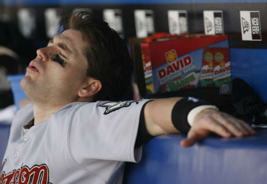 Luke Scott can barely watch the game during Houston's loss to the Braves. Photo: KAREN WARREN, Chronicle