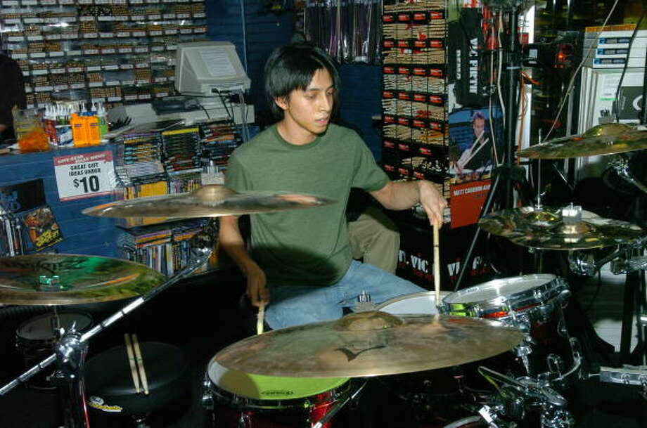 Houston Community College part-time student Isaias Gil, 22, drummer for the local band P.S. 151, was named the district winner of Guitar Center's Drum Off 2006 and will travel to Nashville, Tenn., for the Dec. 6 regional competition. Photo: Eddy Matchette, For The Chronicle