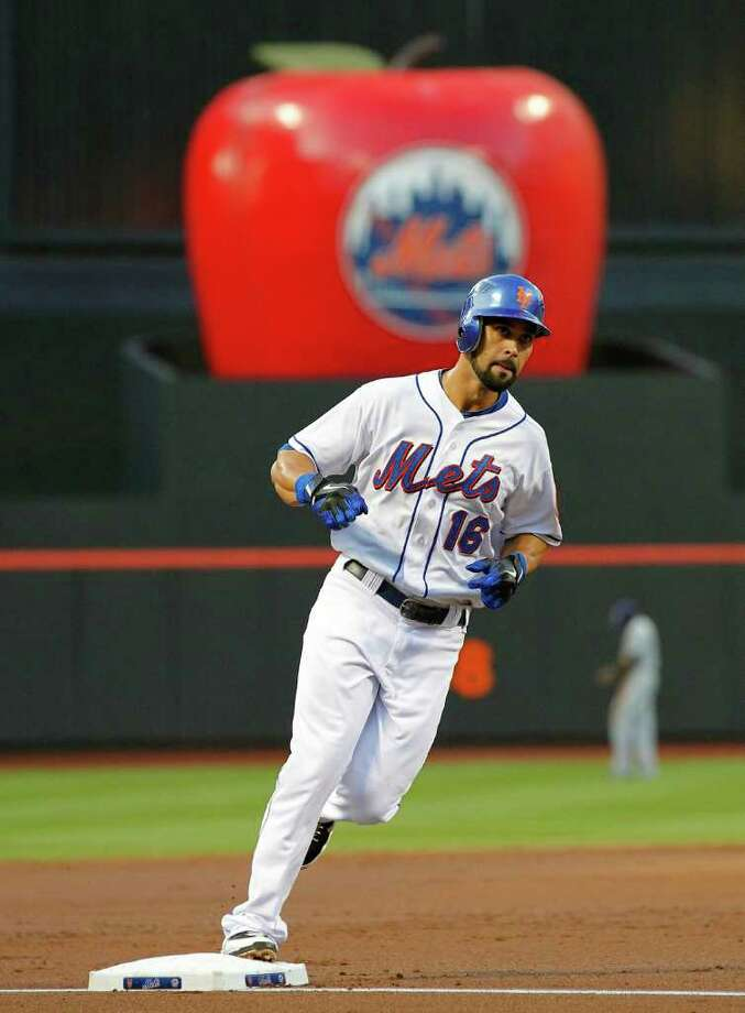 New York Mets' Angel Pagan runs the bases with his home run during the first inning of a baseball game against the San Diego Padres in New York, Monday, Aug. 8, 2011. (AP Photo/Paul J. Bereswill) Photo: Paul Bereswill