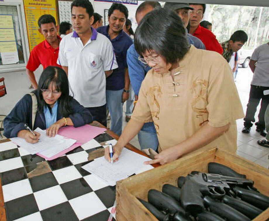 Teachers sign in for a day of shooting practice at the Chulabhorn naval base in southern Thailand. Photo: SAKCHAI LALIT, AP