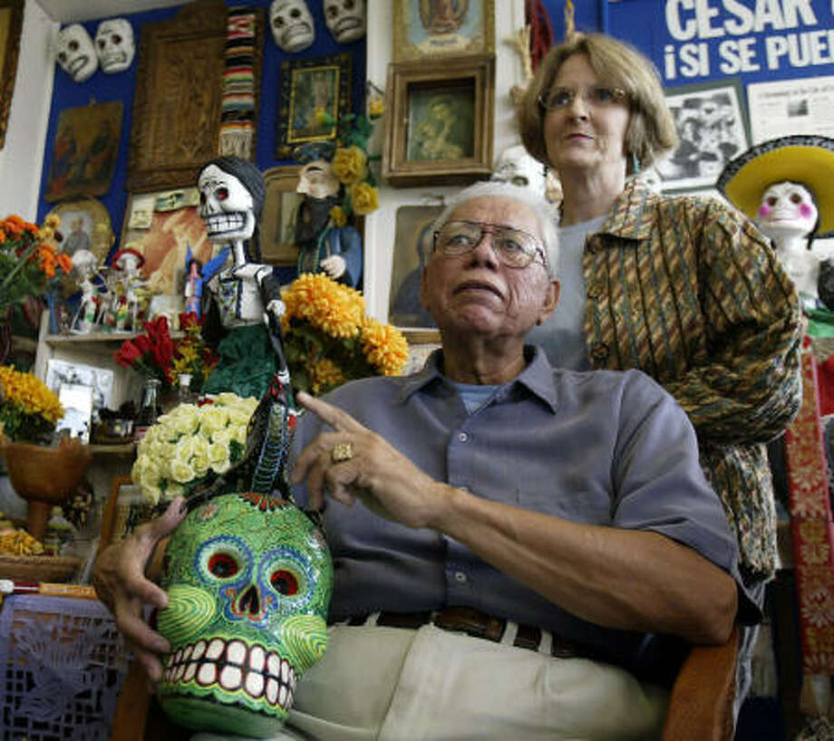 Macario Ramirez and Chrissie Dickerson Ramirez, owners of Casa Ramirez in the Heights, were unable to travel to Oaxaca, Mexico, to buy folk art this year because of a violent teachers strike in the city. Photo: Jessica Kourkounis, For The Chronicle