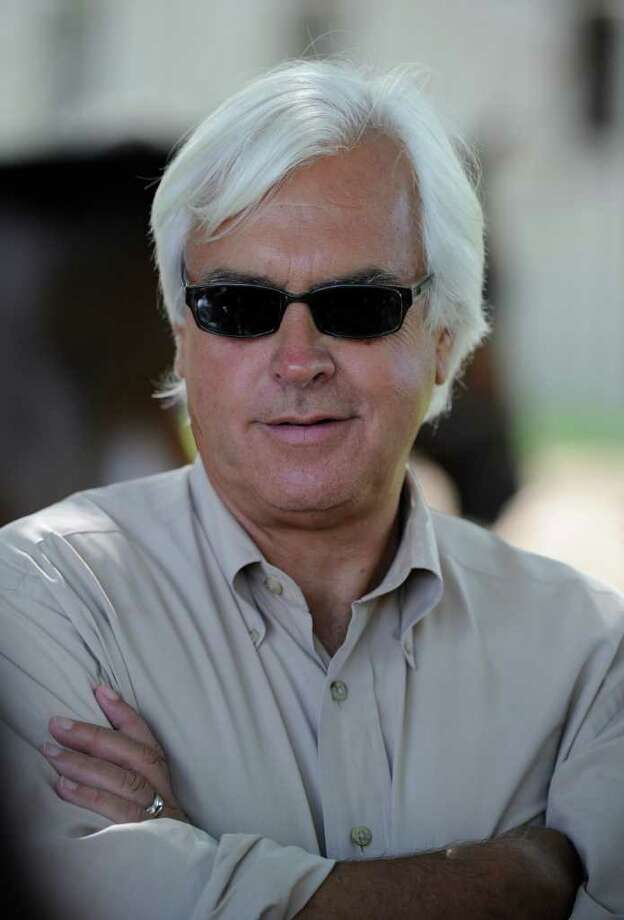Trainer Bob Baffert speaks to the media about Coil and Plum Pretty in the barn area of the Oklahoma Training center near the Saratoga Race Course in Saratoga Springs,N.Y. Aug. 10, 2011.    (Skip Dickstein / Times Union) Photo: SKIP DICKSTEIN