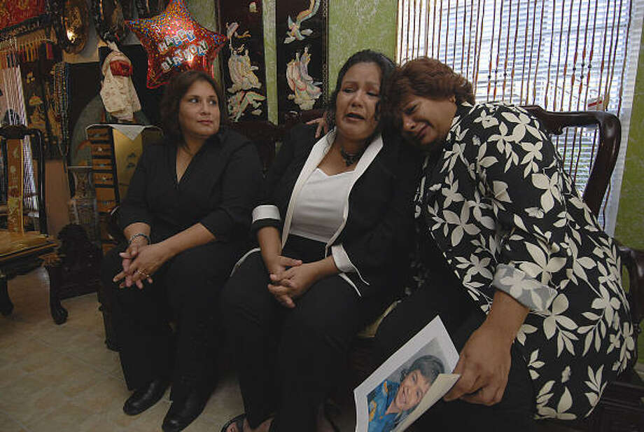 San Juanita Martinez, right, leans on the shoulder of Esmeralda Garza, the daughter she hadn't seen for 21 years, Saturday in Houston. At left is May Ann Gonzales, whose Internet searching found Martinez's daughter and son, Juan Manuel Garza. Photo: Tony Bullard, For The Chronicle