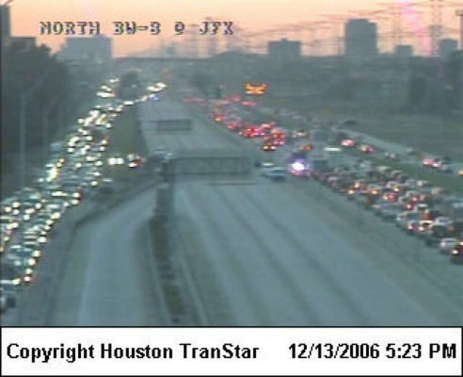 Beltway 8 North eastbound lanes, left, were at a standstill at 5:23 p.m. at JFK Boulevard because of an accident and fire. Photo: Courtesy Houston Transtar