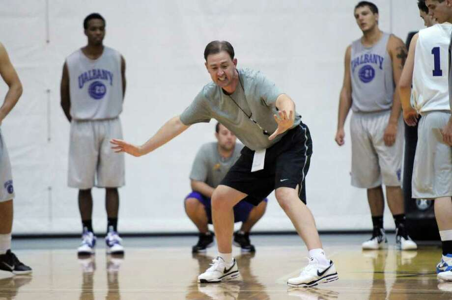 UAlbany men's basketball coach Will Brown leads a practice in preparation for a preseason trip to Canada later this month, at SEFCU Arena on Wednesday Aug. 10, 2011 in Albany, NY.   (Philip Kamrass / Times Union) Photo: Philip Kamrass / 00014204A