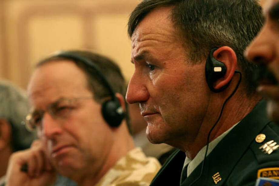U.S. Lt. Gen. Karl W. Eikenberry, commander of Combined Forces Command in Afghanistan, right, and British Lt. Gen. David J. Richards, head of NATO's international security force in Afghanistan, listen to Afghan authorities during a meeting of governors and chiefs of police in Kabul, Afghanistan, Sunday, regarding security problems in the country. Photo: RODRIGO ABD, AP
