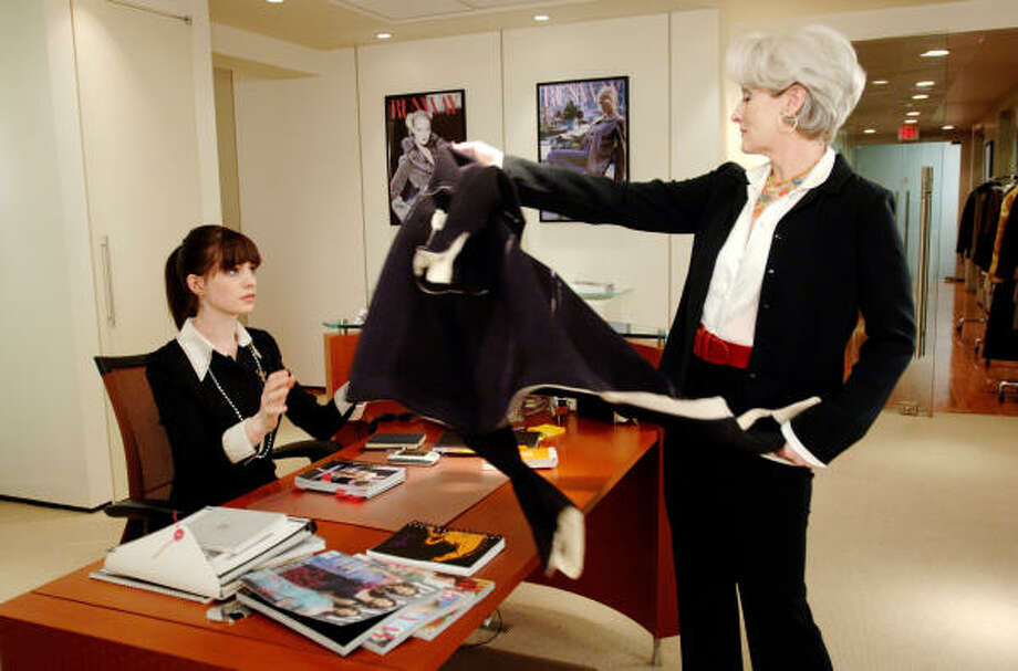 You'll take my coat and you'll like it, says Miranda Priestly (Meryl Streep) in The Devil Wears Prada. Andy Sachs (Anne Hathaway) learned to deal with her demanding boss. Photo: BARRY WETCHER, Associated Press