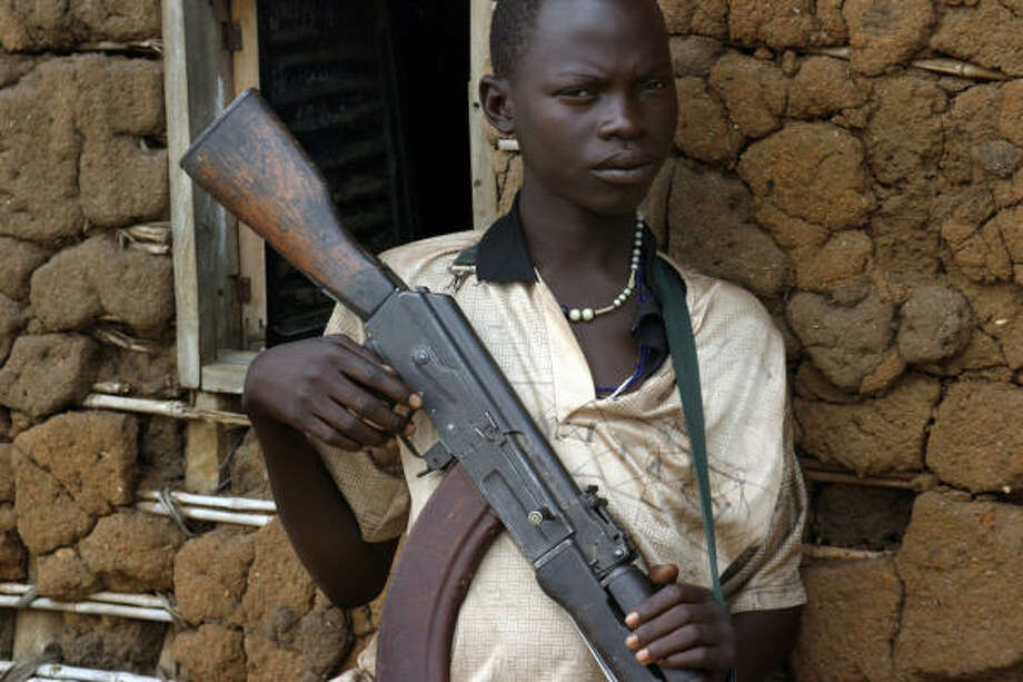 An unidentified teenager with the Congolese Revolutionary Movement guards a rebel stronghold in August. Photo: TUGELA RIDLEY, AFP/Getty Images