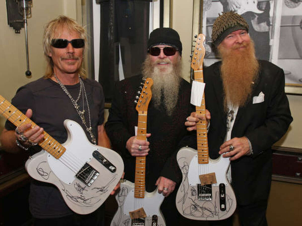 In this photo released by Hard Rock Cafe, ZZ Top members, from left, Frank Beard, Dusty Hill and Billy Gibbons launch their