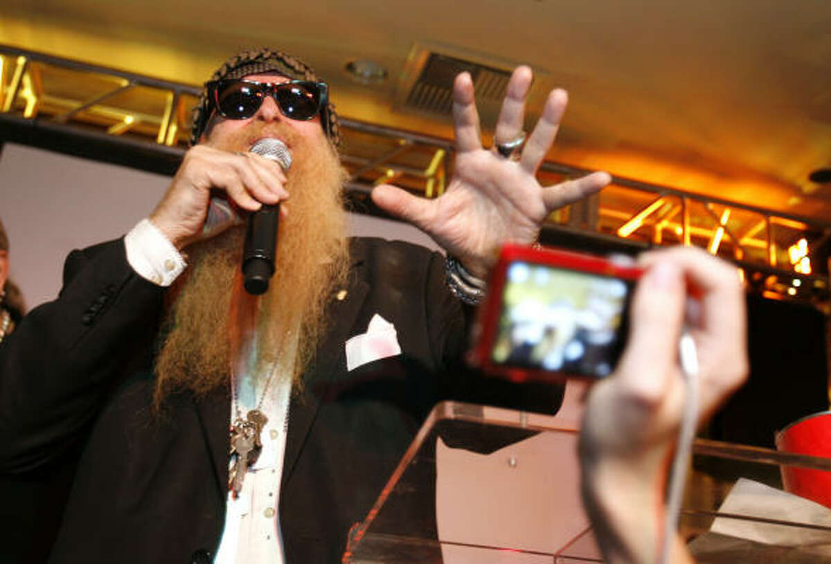 Billy Gibbons talks to the crowd as he and his band mates made an appearance at the Hard Rock Cafe downtown to promote the release of their first DVD, Live in Texas.