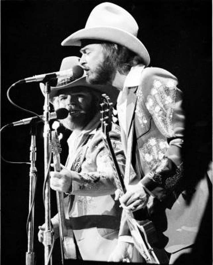 W, western. ZZ Top plays both kinds of music: country AND western. And blues. And a little swing. Photo: Jerry Click, Houston Chronicle