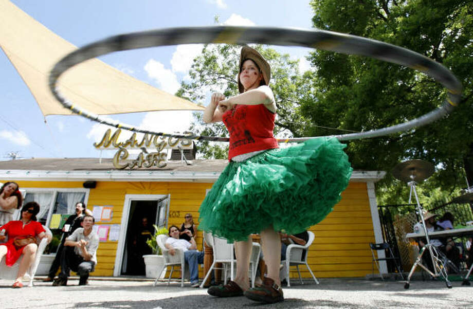 Olivia Dvorak hula hoops in front of Mangos Cafe during the Westheimer Block Party in May of this year. Photo: Sharon Steinmann, Chronicle