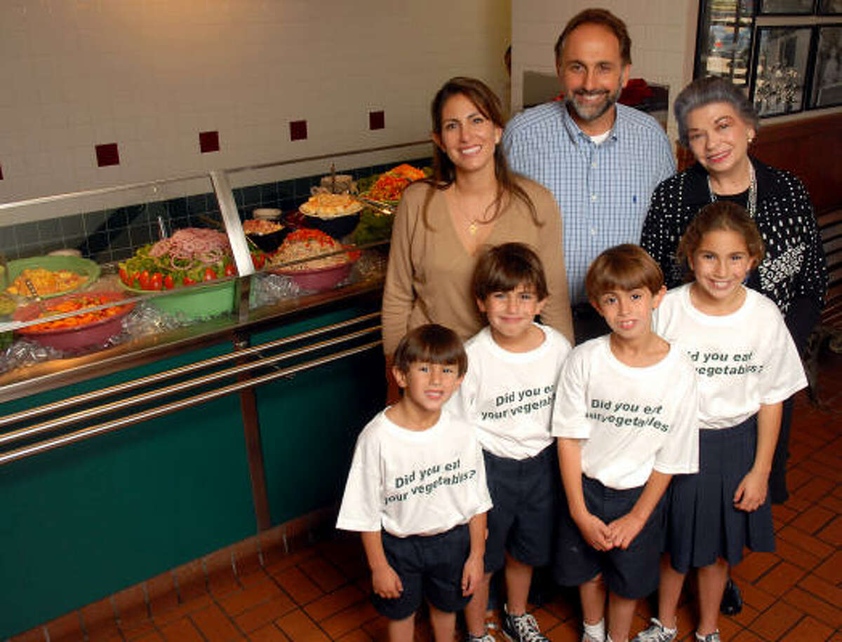 Cleburne Cafeteria owner George Mickelis joins his wife, Michelle, and his mother, Patricia, at the restaurant. In front, from left, are George and Michelle Mickelis' four children - Matthew, 4, Anthony, 7, Nickolas, 8, and Athena, 10.