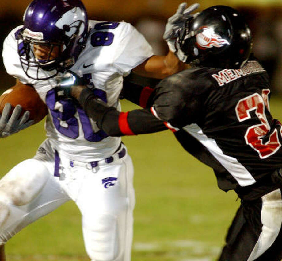 Robert Perry of Humble shows off his stiff-arm technique in the first half. Photo: Andrew Nenque, Beaumont Enterprise