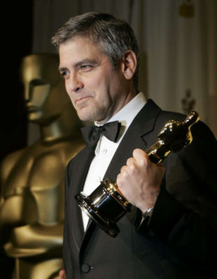 George Clooney won the Oscar for best supporting actor this year for his role in Syriana. He donated his Oscar swag bag to the United Way, which auctioned it for $45,100. Photo: REED SAXON, Associated Press
