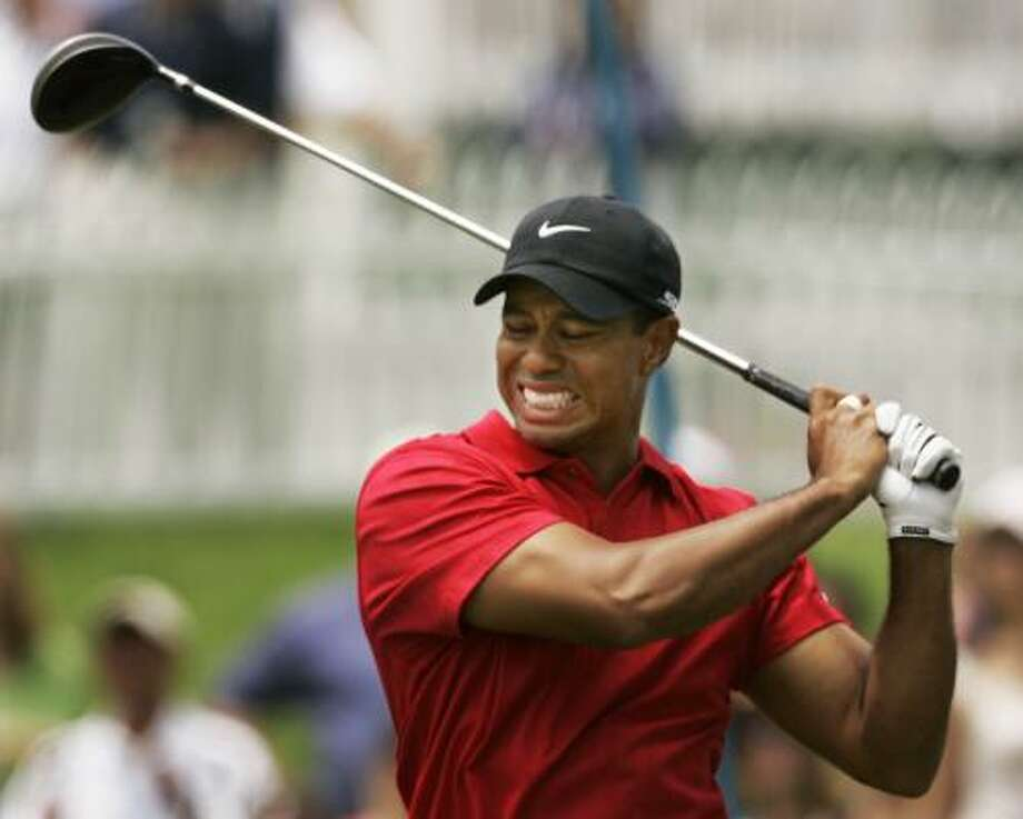 June 2008:Tiger Woods grimaces after teeing during the U.S. Open championship. Injury: Stress fracture. Result: U.S. open champion. Photo: Charlie Riedel, AP