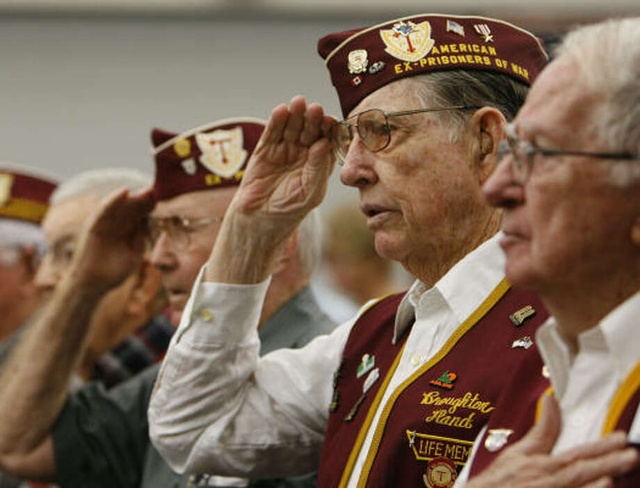 World War II POWs, from left, Thomas Moore, of Richmond; Brodie Hand, of Anahuac; and Robert Jackson, of Vidor, participate on National POW/MIA Recognition Day at Michael E. DeBakey VA Medical Center. Photo: James Nielsen, Chronicle