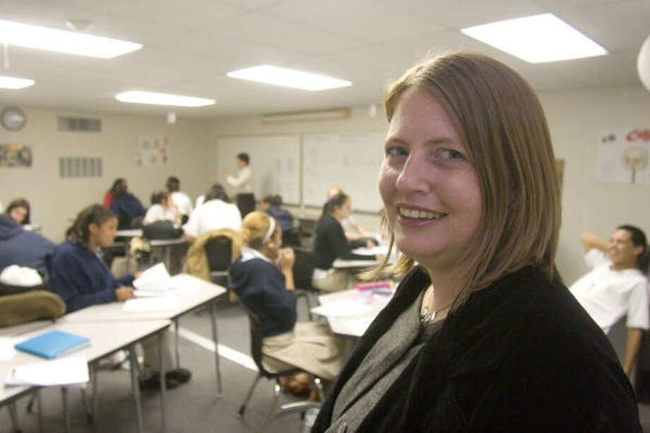 Melissa Jacobs-Thibaut, principal of the Houston Academy for International Studies, visits a Chinese language class. Photo: R. Clayton McKee, For The Chronicle