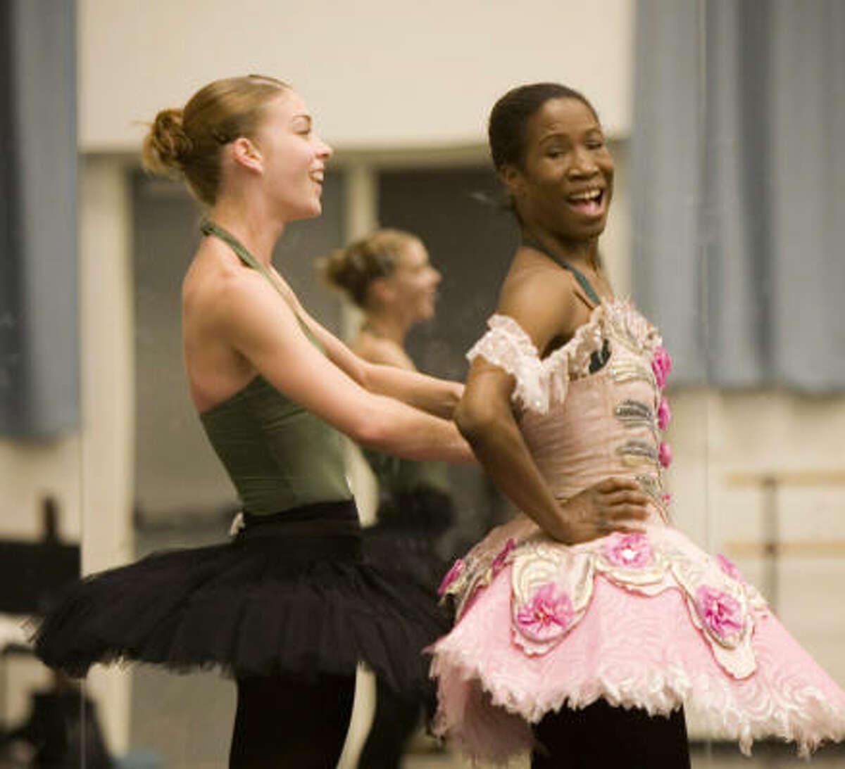 GOOD TIMES: Houston Ballet principal dancer Lauren Anderson laughs as dancer Jaquel Andrews helps her with her costume.