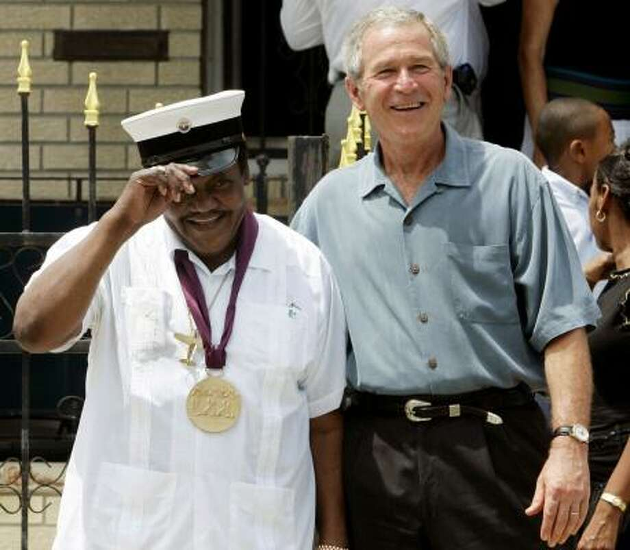 President Bush meets with musician Fats Domino in New Orleans. Bush returned to the jazz city and promised the federal government would do better if another disaster hit. Photo: JIM YOUNG, REUTERS