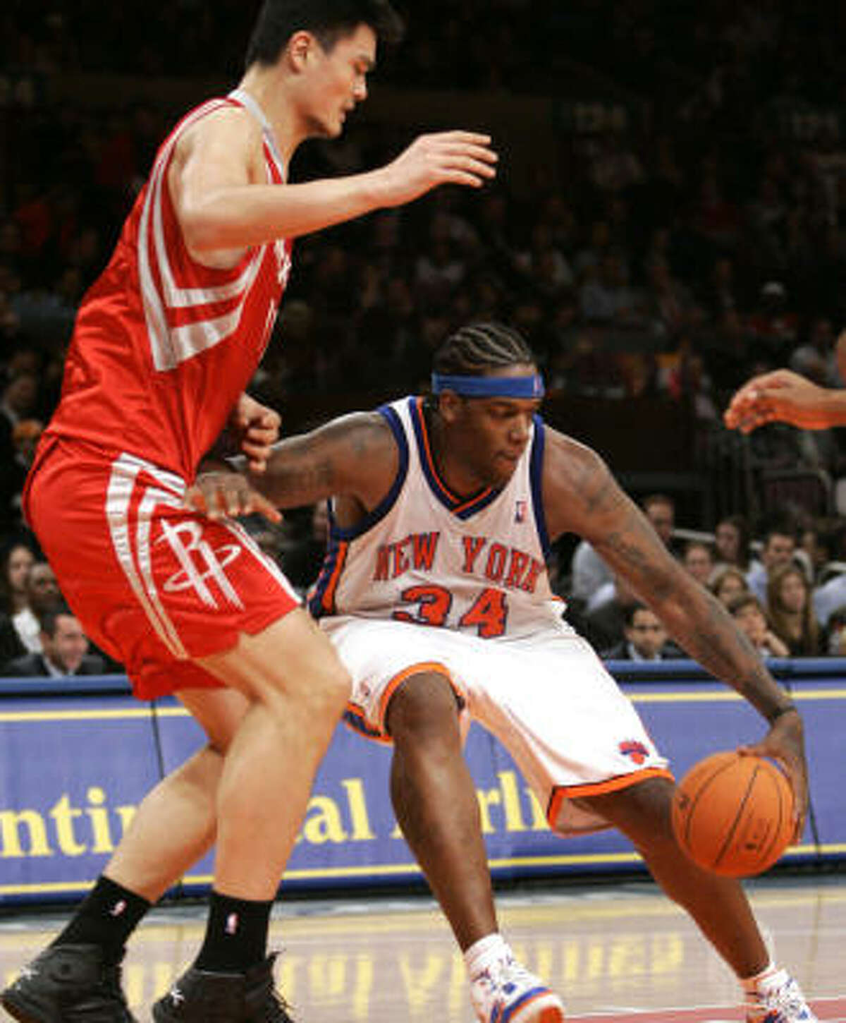 New York's Eddy Curry (34) gets a little elbow room between himself and Yao Ming.