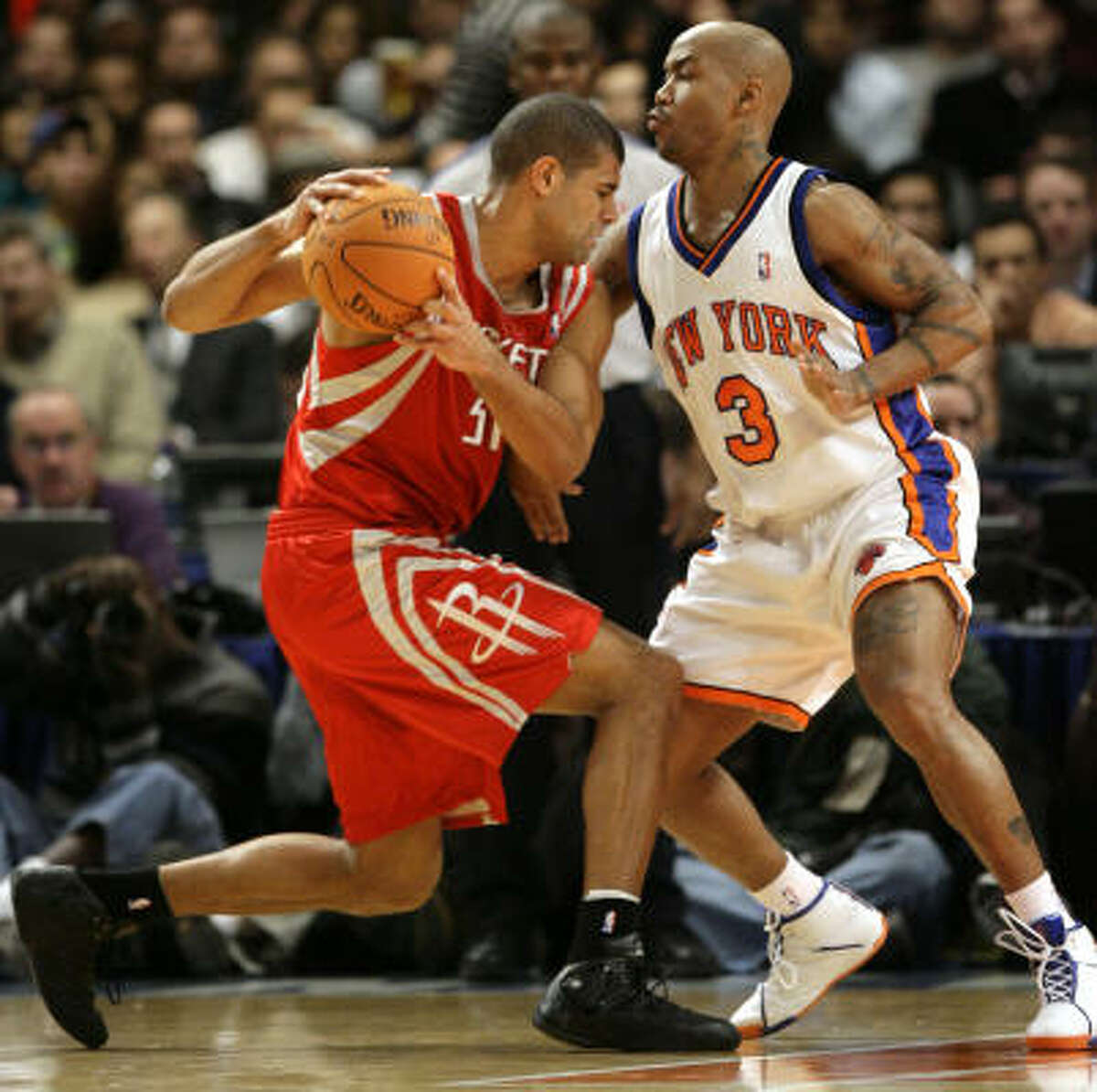 Stephon Marbury (3) slows down Shane Battier of the Rockets. Marbury and former Rockets guard Steve Francis each saw less than 20 minutes of action for the Knicks.