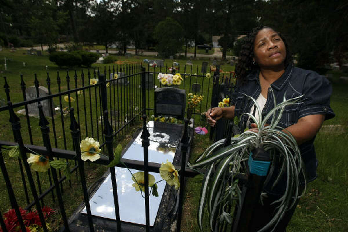 Betty Boatner, one of Byrds six sisters, stands next to his grave in the Jasper City Cemetery. Boatner says she forgives her brothers killers and says the community has been changed for the better through the death of her brother.