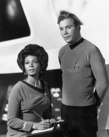 Gene Roddenberry's futuristic Star Trek, featured William Shatner as Capt. Kirk and Nichelle Nichols as Lt. Uhura.