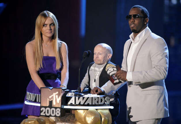Lindsay Lohan, left, Verne Troyer,center, and Sean Diddy Combs look like they don't know what they're doing together either. Photo: Mark J. Terrill, AP