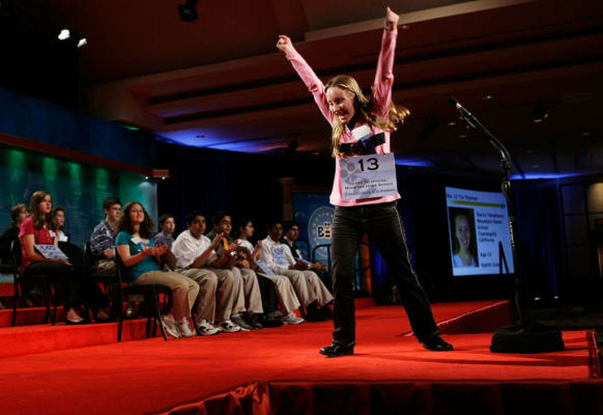 Tia Natasha-Elizabeth Thomas of Coarsegold, California celebrates after she correctly spelled her word during round six of the 2008 Scripps National Spelling Bee.