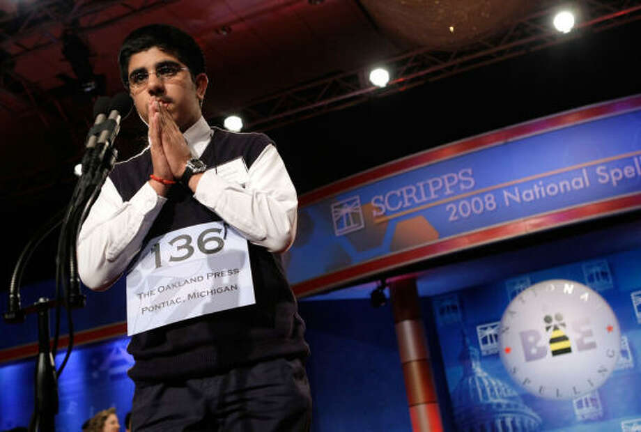 """Sidharth Chand of Bloomfield Hills, Michigan, reacts after he misspelled the word """"prosopopoeia"""" and was eliminated. Photo: Alex Wong, Getty Images"""