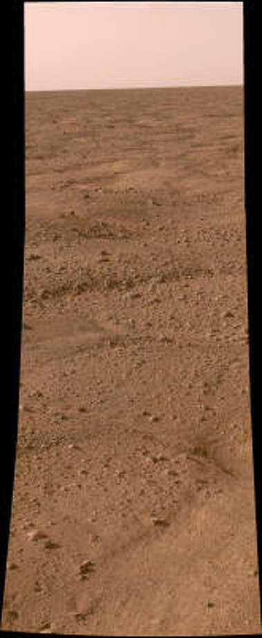 One of the first photos captured by NASA's Phoenix Mars Lander shows the vast plains of the northern polar region of Mars. Photo: NASA