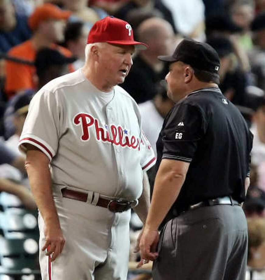 Phillies manager Charlie Manuel argues in vain on behalf of Ryan Howard, saying Howard's shot should have been a home run. Photo: PAT SULLIVAN, AP