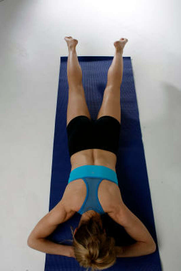 BEAT ON THE BELLY:Inhale as you tap feet together, counting to 5. Exhale as you tap feet 5 more times. Your goal is 100 taps. Use pelvic floor muscles and inner thighs to get extra booty work. Photo: Johnny Hanson, Chronicle