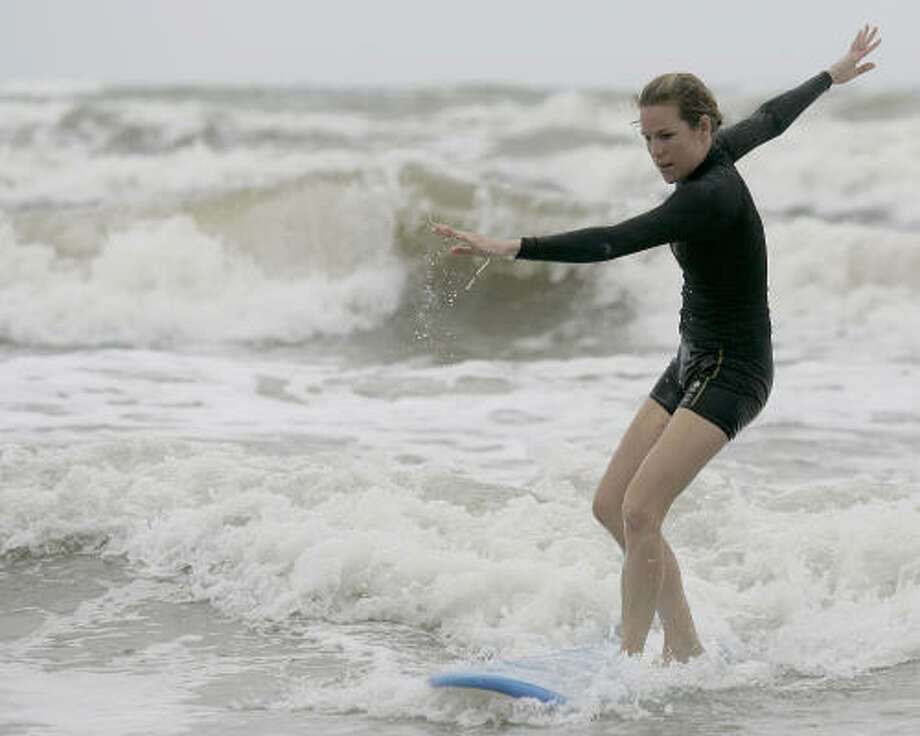If Chronicle reporter Kristin Finan can take surfing lessons at Galveston Beach, you can, too. Photo: Thomas B. Shea, For The Chronicle