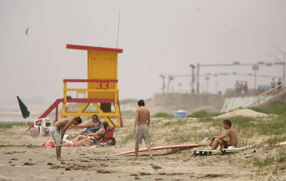 If you don't feel like getting wet, soak up some rays at Galveston Beach. Photo: Thomas B. Shea, For The Chronicle