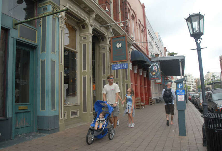 The Strand in Galveston offers interesting shops and retaurants and the chance to take the family out for a stroll. Photo: Megan True, Chronicle
