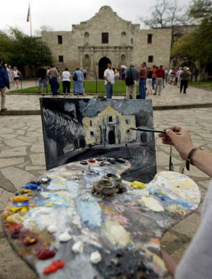 Remember the Alamo! Only a few hours away is San Antonio. Here, artist Seth Camm works on a painting of the Alamo at Alamo Plaza in San Antonio on March 25, 2004. Photo: ERIC GAY, AP