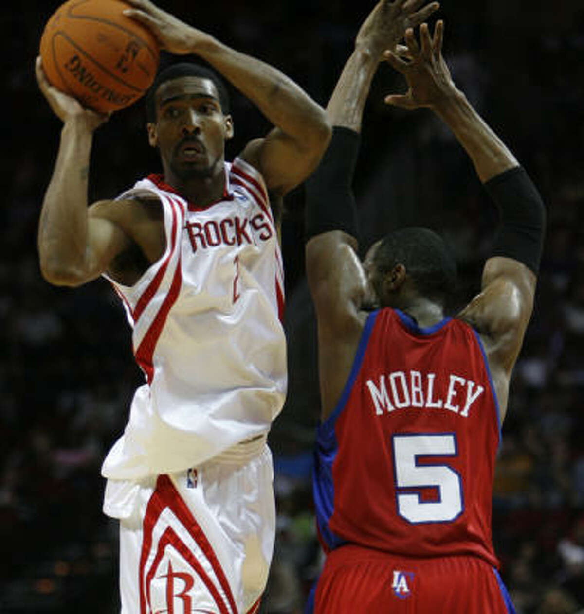 Rockets guard Luther Head looks for room around former Rockets guard Cuttino Mobley.