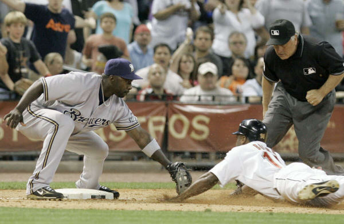 SIXTH INNING: Brewers third baseman Bill Hall, left, makes the tag for the out on Astros outfielder Michael Bourn.