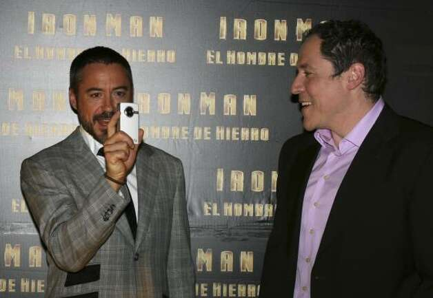 Mexico City: Robert Downey Jr. takes a photo of photographers as film director John Favreau looks on. Photo: Jorge Rios, AP